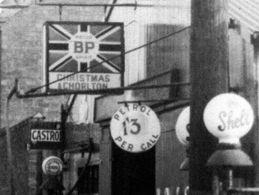 Signs at Christmas & Chorlton's garage, High St, 1928 | By permission of Miss Angela Marsh