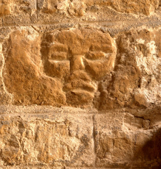 The crude face, a piece of 'folk art' carved in the stones on the inside of the church porch at St Mary's. | Neil Fortey, 21/4/2014