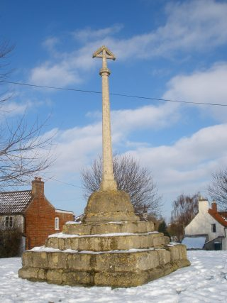 Muston Market Cross in winter. | Bottesford Local History Archive