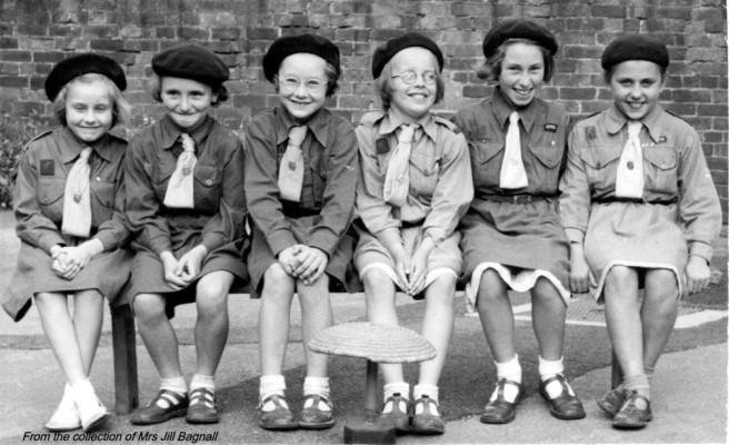 Six of the Brownies sitting on a bench probably in the old school yard | From the collection of Jill Bagnall