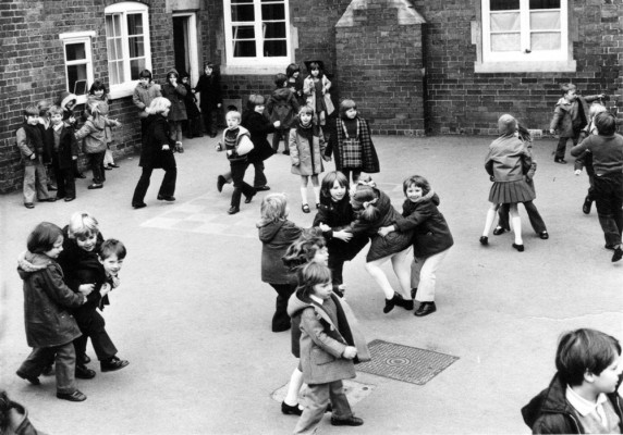 Children playing in the school yard in 1975