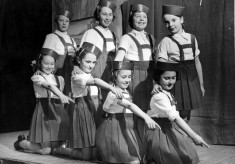 Brownies pose during a stage performance
