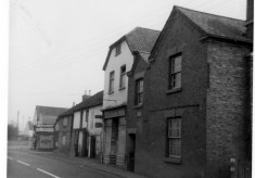 The row of old shops on the High Street, all demolished except for the far end
