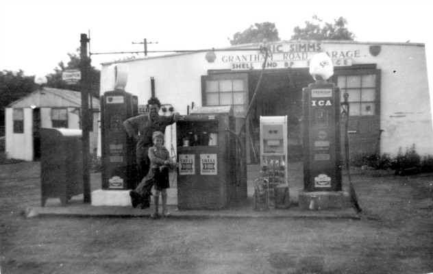 Eric Simms and son outside the garage on Grantham Road