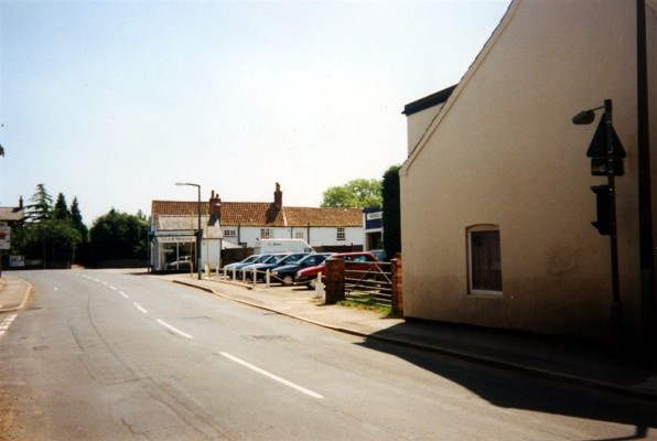 Snap shot of Nichols Car Sales and the Mower Shop on the High Street