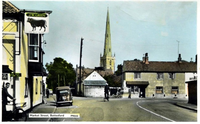 An old postcard of Bottesford Market Place and Cross