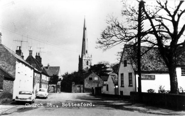old postcard of Bottesford Church Street