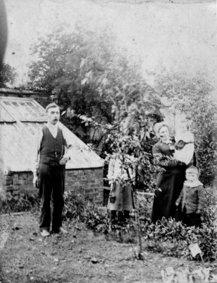 Old picture of the Samuel family in vegetable plot