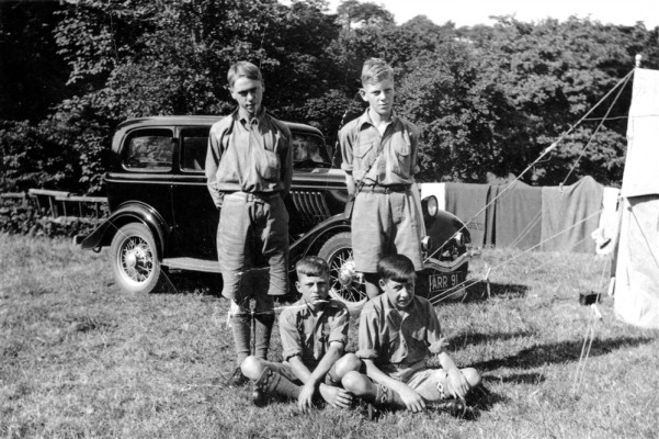 Scouts on camp, car in background