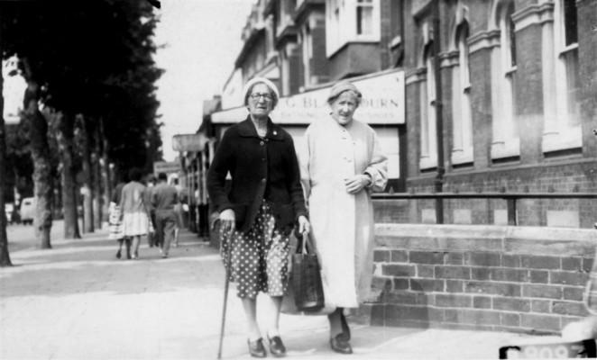 Two elderly ladies strolling through Skegness