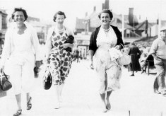 Three ladies strolling probably along the front in Skegness