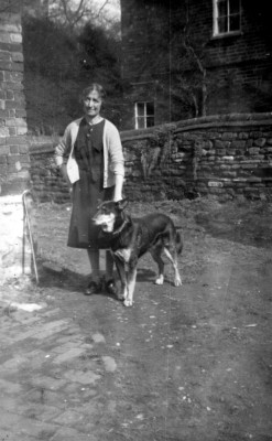Mrs Bateson with dog in Six Bells yard