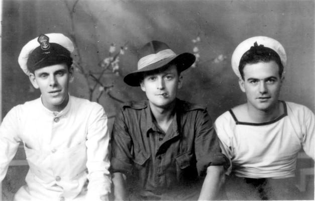 Studio portrait of three wartime servicemen