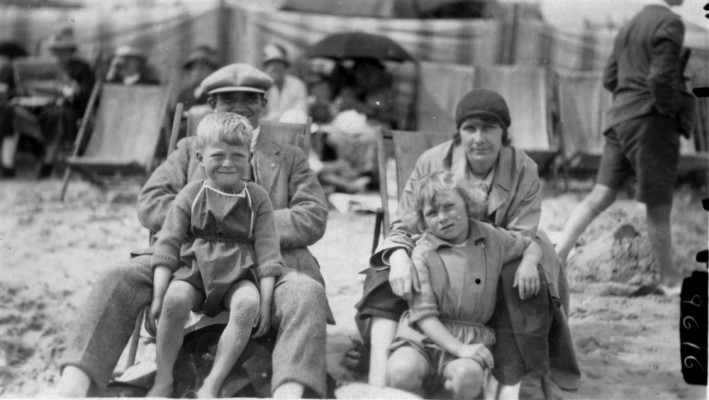 family in deck chairs on beach at Skegness
