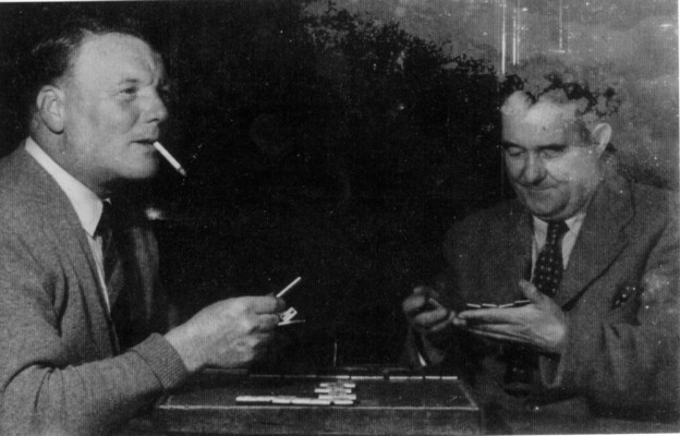 Two men playing dominoes in Rutland Arms