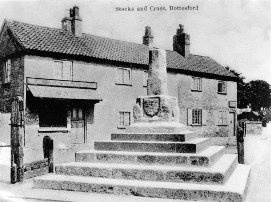 Postcard of Stock and Cross, shops behind