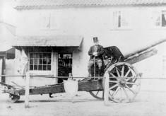 German gun in front of Taylor's shop