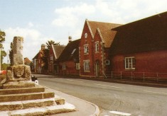 Colour postcard of Market Cross and village school