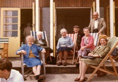 colour picture of elderly group in deckchairs at seaside