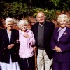 colour picture of four friends in Church St, Mrs Ada Bond second from left