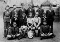 village school boys sports team in school yard