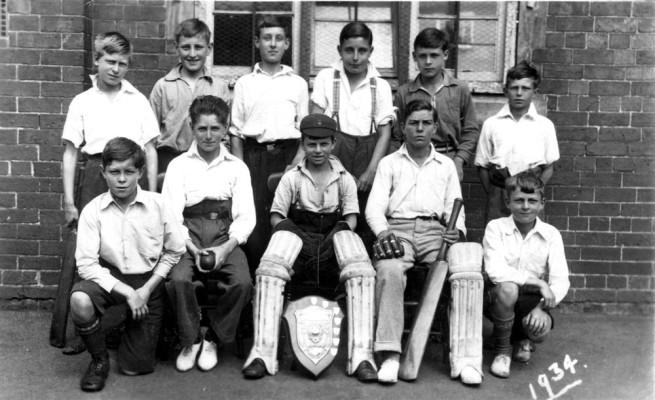 village school cricket team in school yard 1934