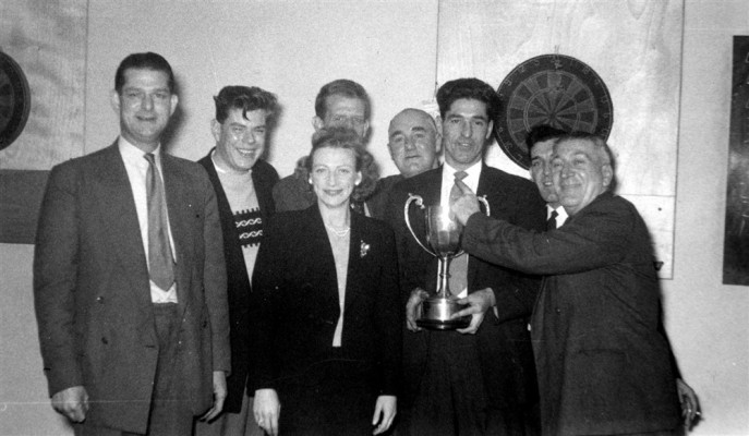 darts team posing with trophy