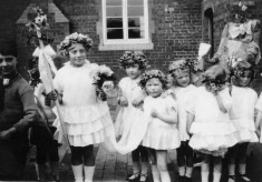 infants parade with May Queen in school yard