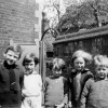 group of six children in a yard
