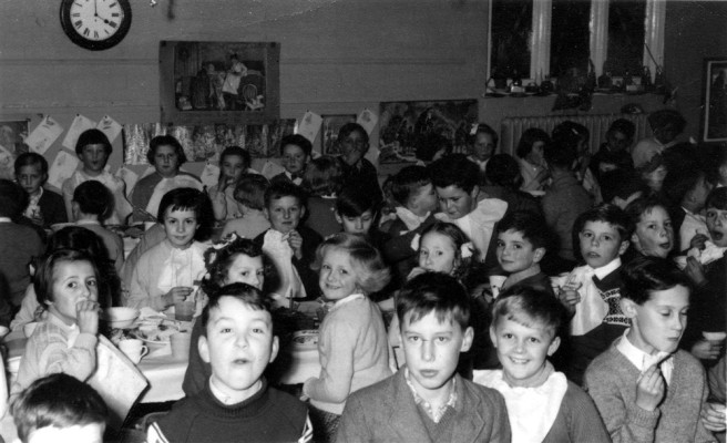 village school children enjoying school dinner