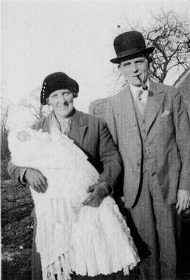 picture of grandparents holding new grandchild