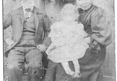 early picture of elderly couple with infant on knee
