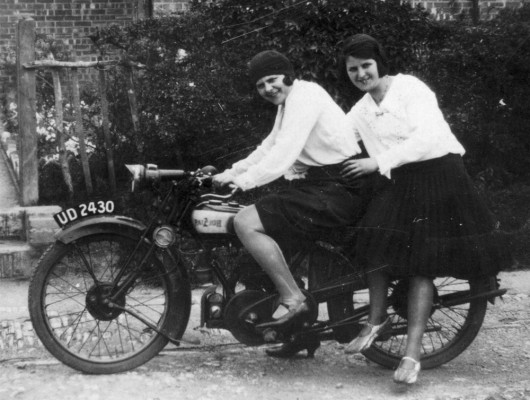 Mary and Margaret Topps trying out a motorbike