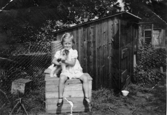 Gina Topps and pet terrier in a garden