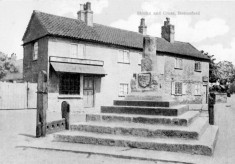 Postcard of Cross and Stocks at Bottesford