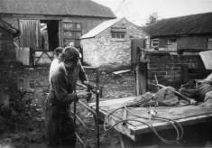 Trainee hands fixing a farm gate at Church Farm