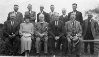 A copy of the photograph displayed in the club room of Bottesford Bowls Club, Belvoir Road. The occasion is the opening of the Bowls Club in 1947/1948. John Thomas Ravell is standing, third from the left. | Bottesford Heritage Archive BOT/014/122. From the collection of Angela Marsh
