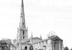 A postcard of Bottesford church seen across the churchyard