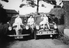 Girls sitting on the car bonnets at Beckingthorpe Farm