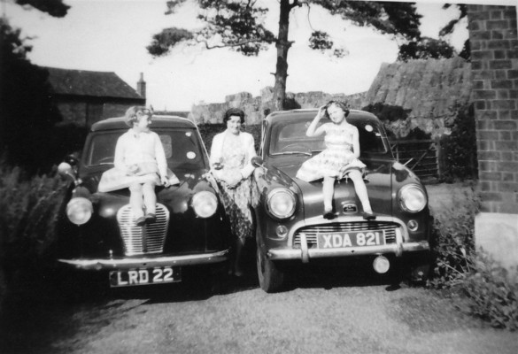 Girls sitting on the car bonnets at Beckingthorpe Farm