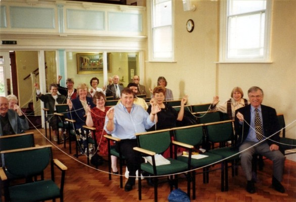 Members of the chapel trying out the new seating - 1