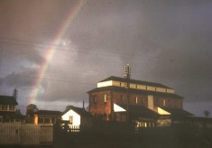 Bottesford Station grain store, rainbow in sky