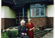 Elderly ladies by bungalow