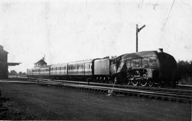 Express locomotive pulling a train through Bottesford Station