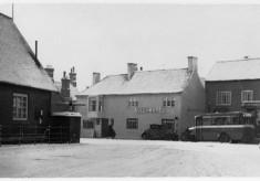 Bottesford Market Place under snow, Bull Inn, Randell's bus
