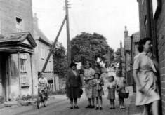 Ladies and children in Chapel Street, Singleton's farmhouse on left