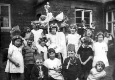 May Queen and children in village school yard