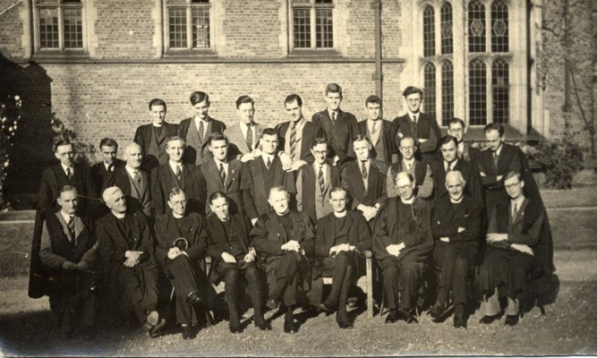 Group photograph, students and tutors, location uncertain