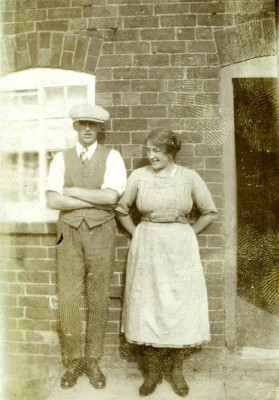 Couple outside cottage door
