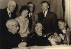 Canon Blackmore with his wife and friends examines a book in Bottesford's Old Rectory